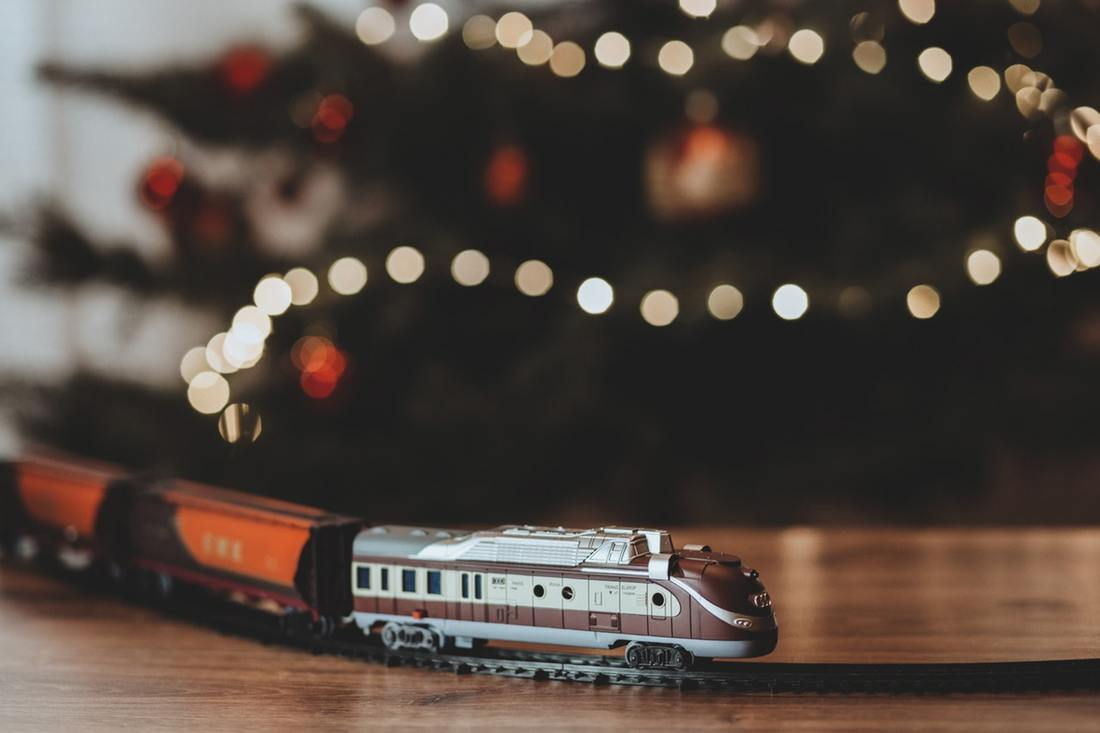 Model train around Christmas tree